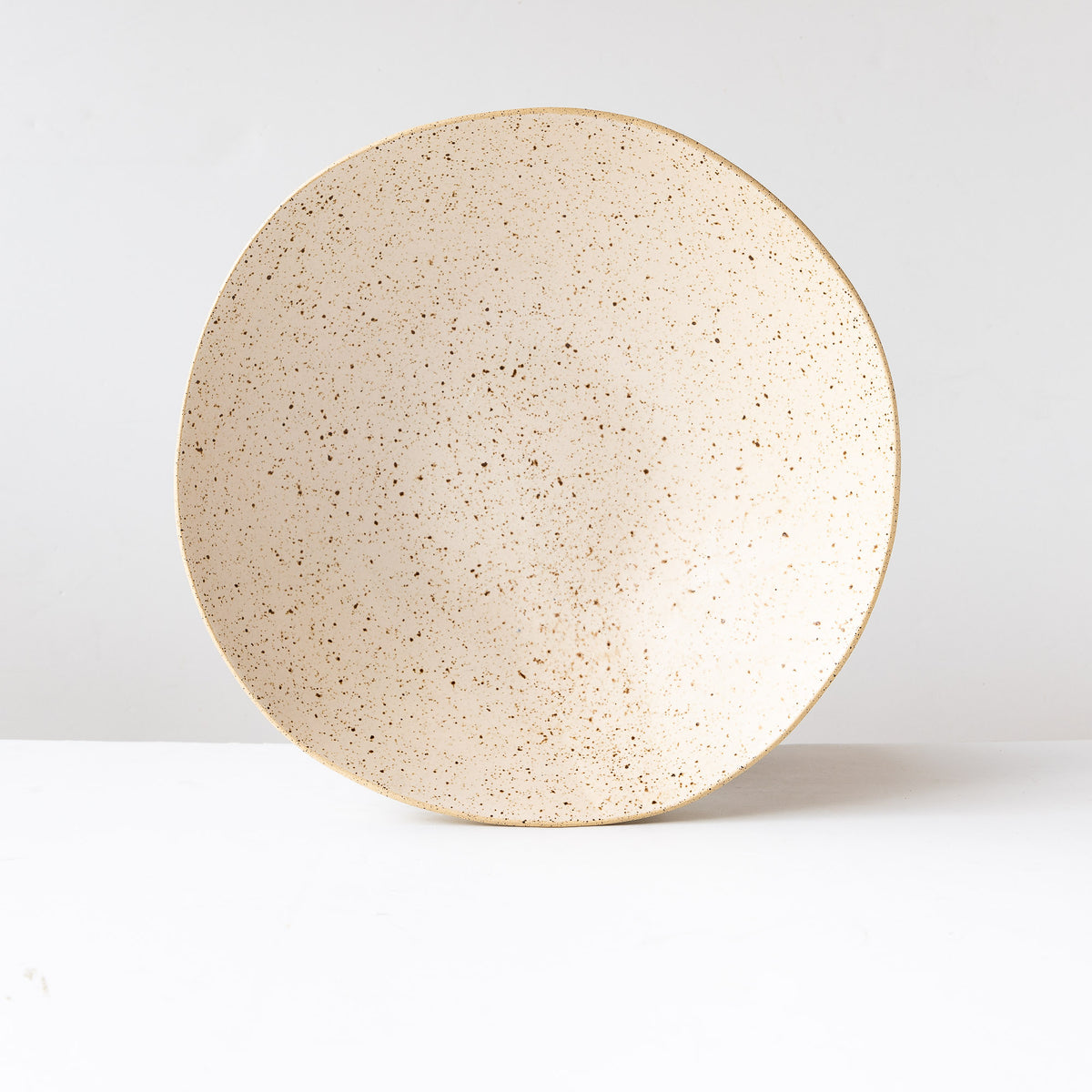 Standing View - Freckled Off-White - Handcrafted Large Freckled Stoneware Fruit Bowl - Sold by Chic & Basta