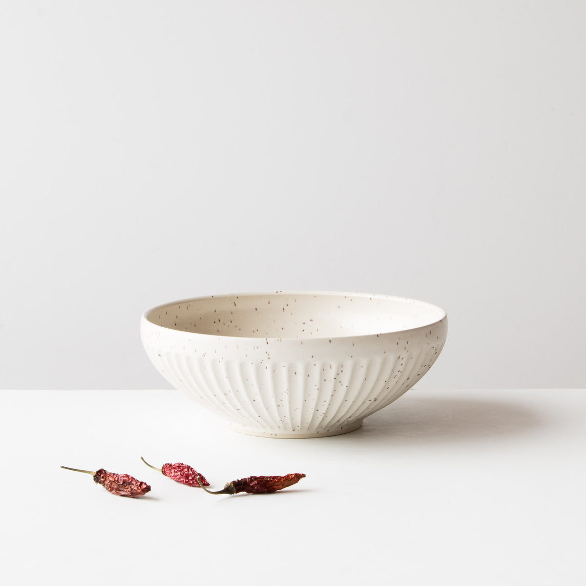 Speckled Off-White - Large Hand Thrown Ceramic Bowl - Groove Pattern - Sold by Chic & Basta
