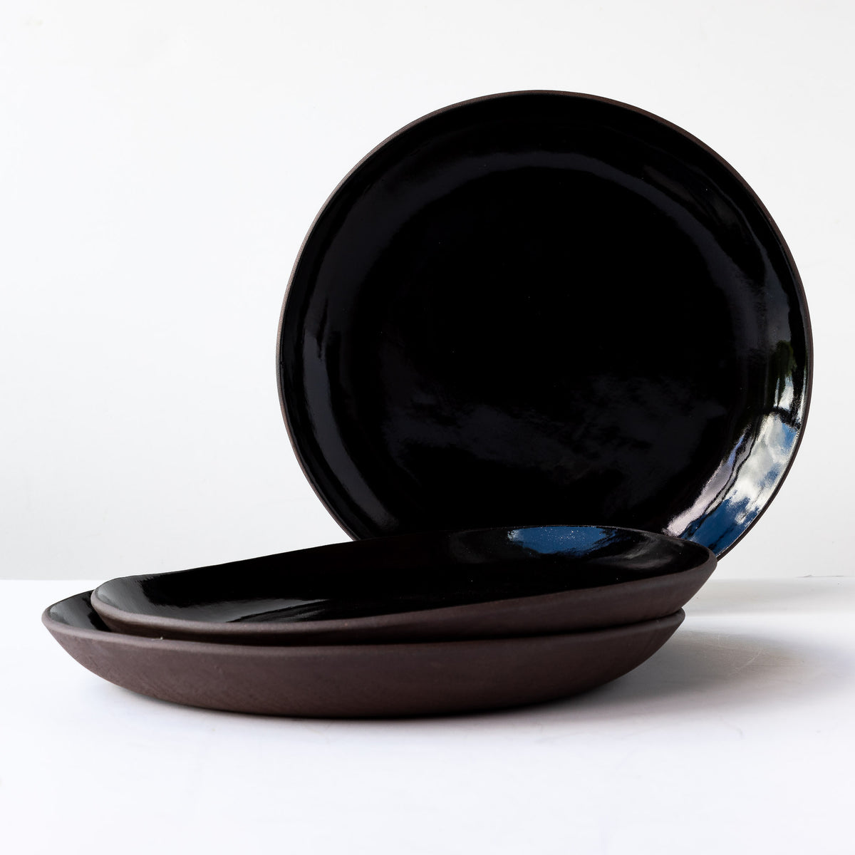 Three Handmade Large Plates in Black Lacquered Stoneware - Sold by Chic & Basta