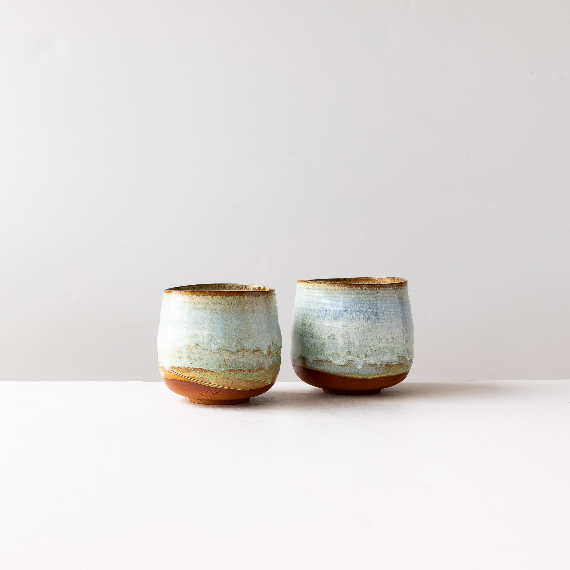 Two Large Tumblers in Red Stoneware & Turquoise Glaze - Sold by Chic & Basta
