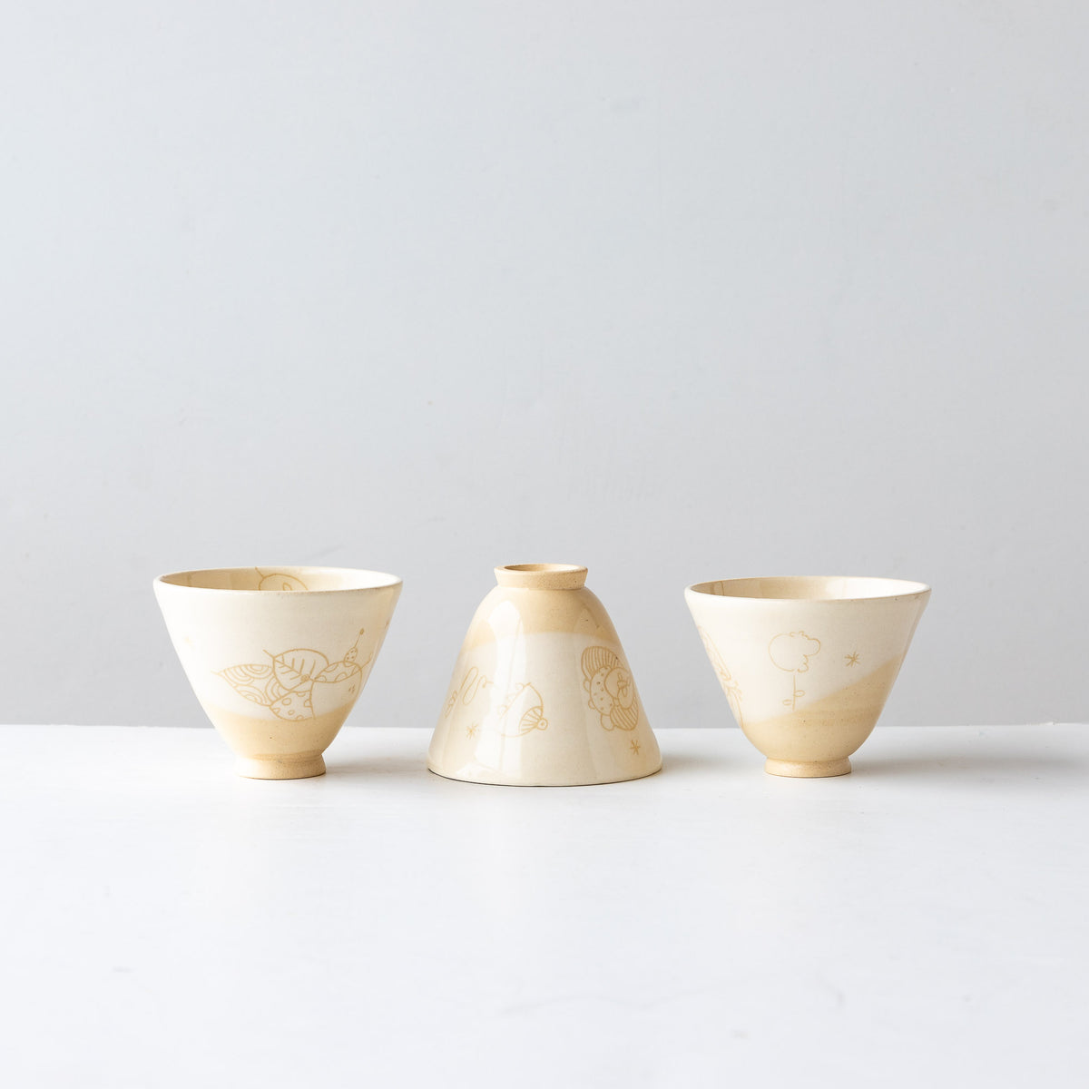 Three Creamy White Lil' Hand Painted Earthenware Bowls - Sold by Chic & Basta