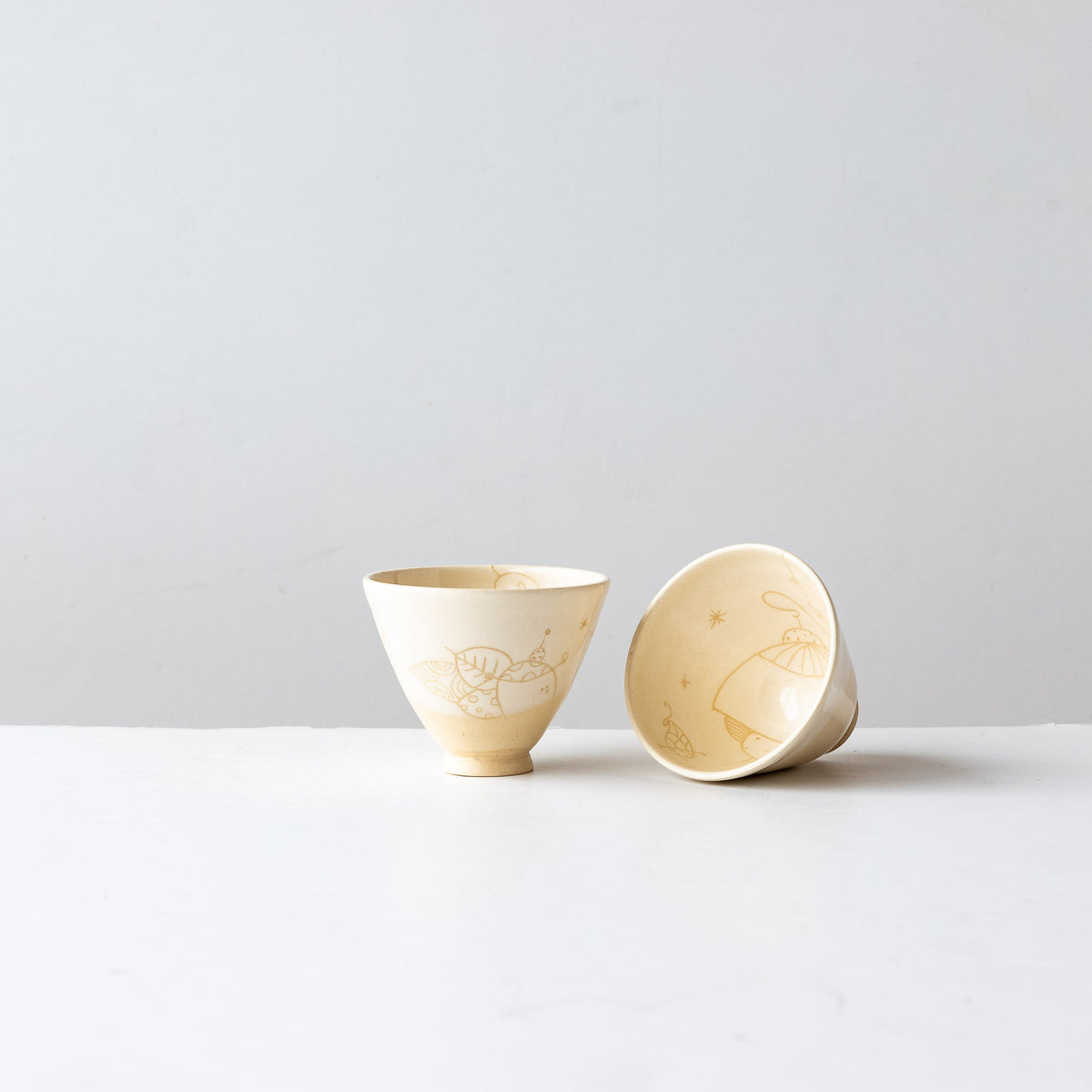 Two Creamy White Lil' Hand Painted Earthenware Bowls - Sold by Chic & Basta