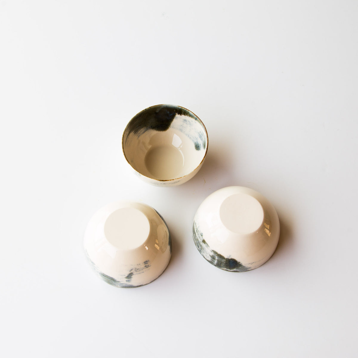 Each of these elegant little bowls painted in delicate porcelain is handmade, carved and sanded. Stackable and slightly imperfect bowls!