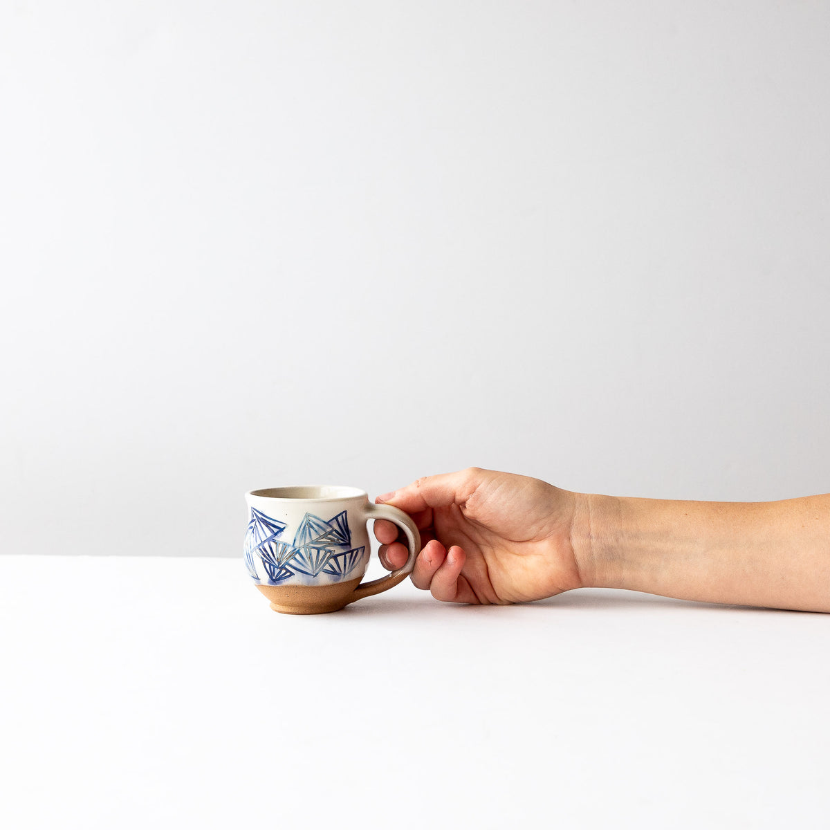 Model Holding an Handmade Mishima Espresso Cup With Folding Fan Pattern - Sold by Chic & Basta