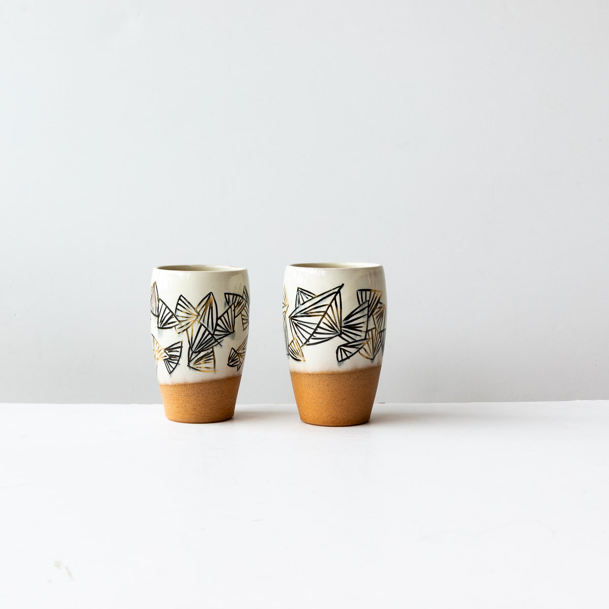 Two Handmade Mishima Stoneware Glassses With Black & Gold Folding Fan Pattern - Sold by Chic & Basta