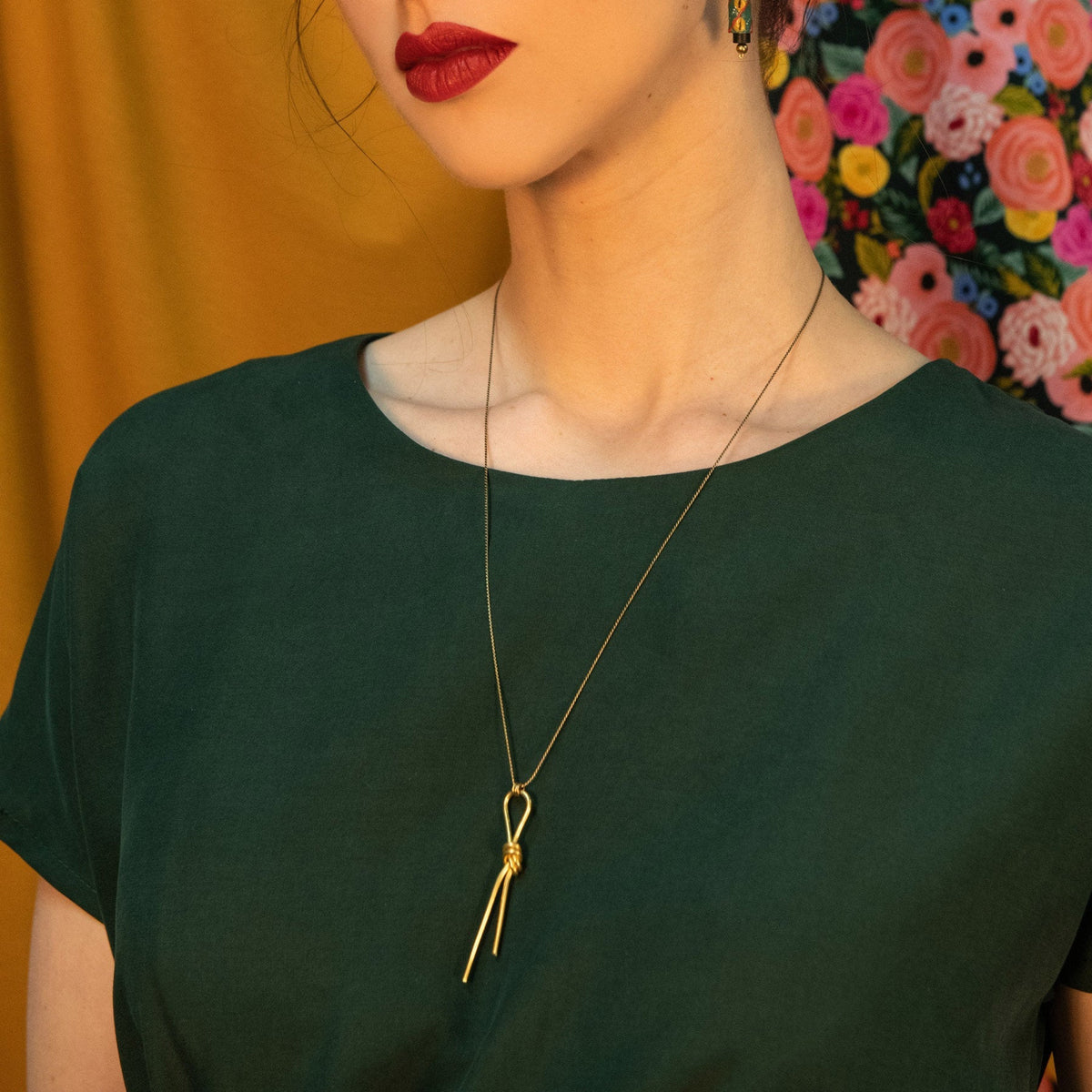 Model Wearing Lodo Necklace - Handcrafted in Brass - Sold by Chic & Basta