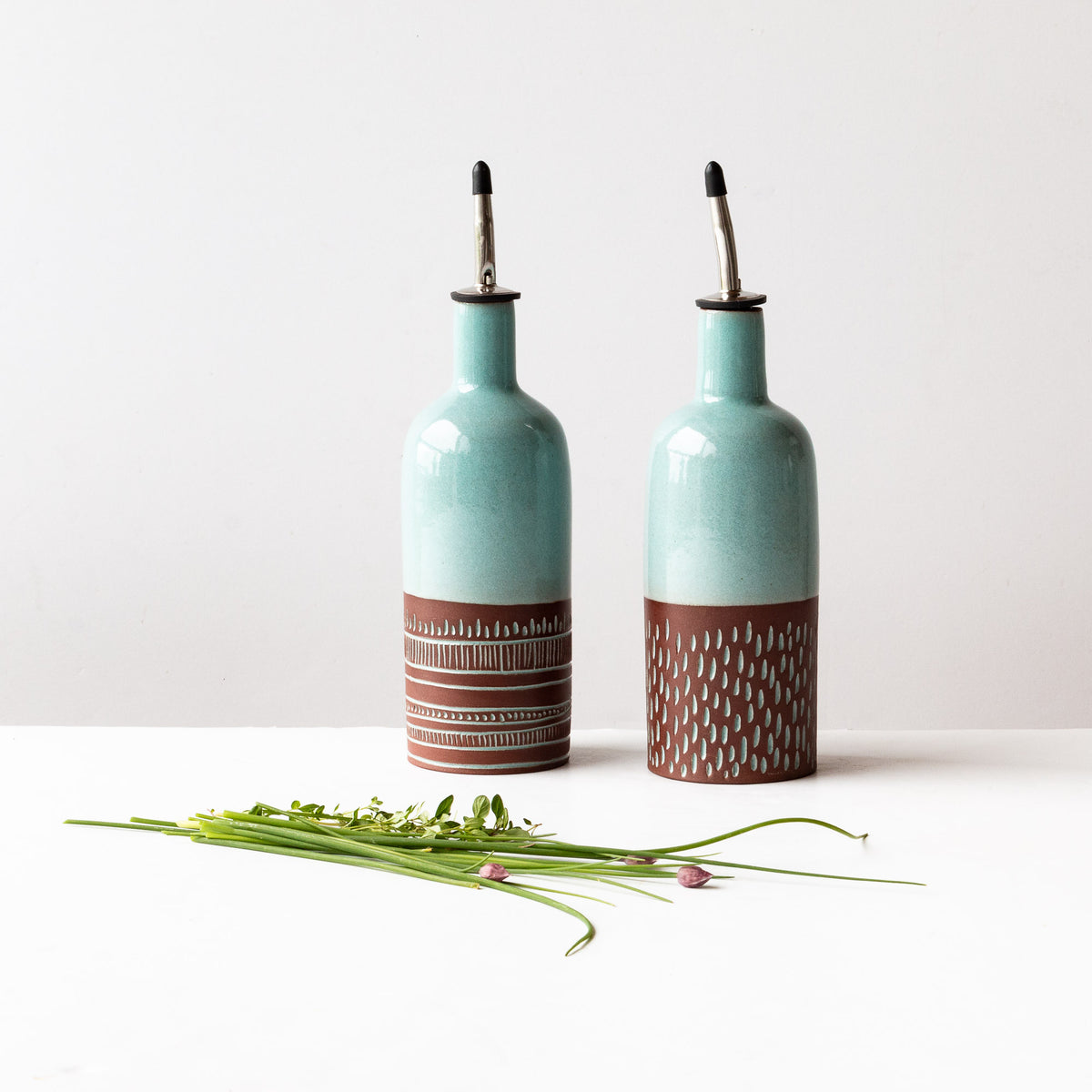 Two Oil or Vinegar Bottles - Handmade in Dark Red Clay Pottery - Sold by Chic & Basta