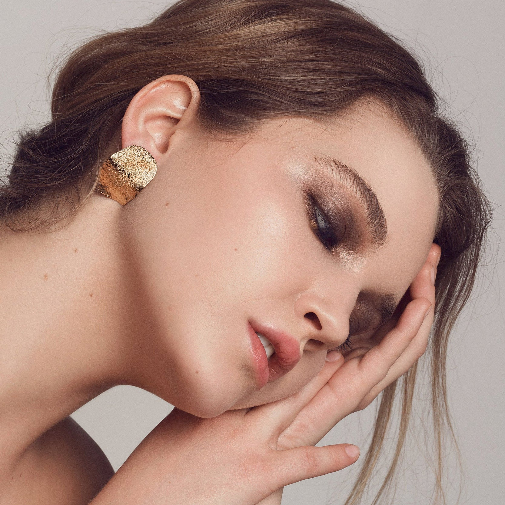 Olas - Model Wearing an Handmade Golden Earrings in Silver & Gold - Sold by Chic & Basta