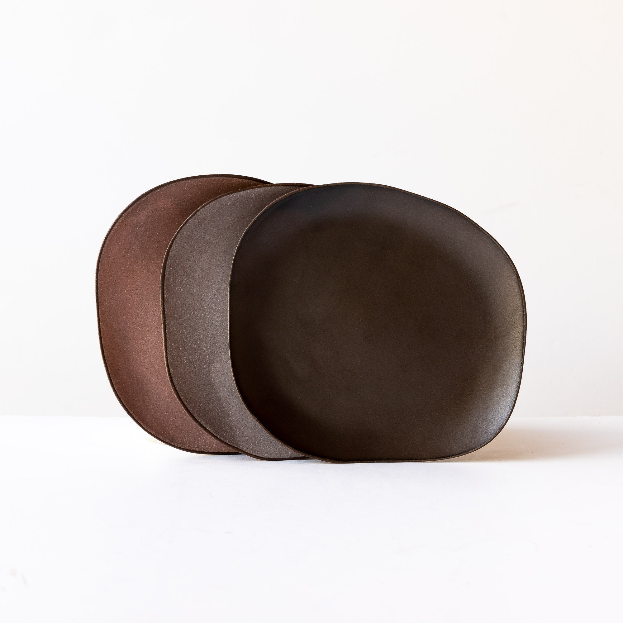 Three Handcrafted Organic Shaped Medium Stoneware Plates - Sold by Chic & Basta