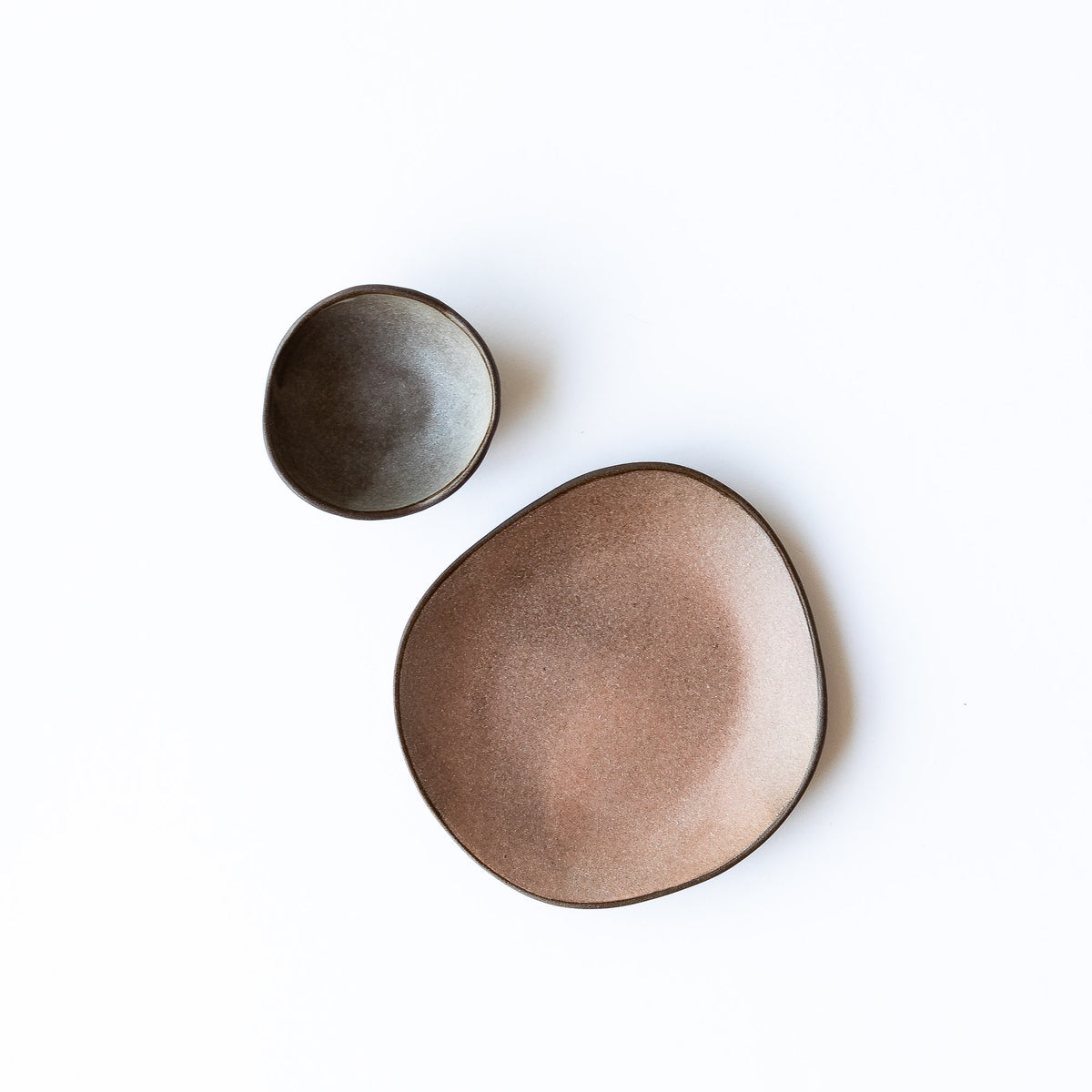 Top View - Handmade Organic Shaped Stoneware Plates of Different Size - Sold by Chic & Basta