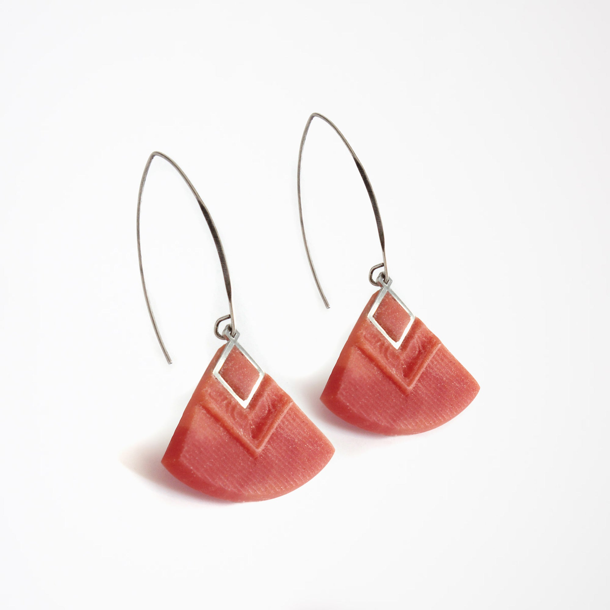Woman Wearing a Cléopâtre Earrings in Coral - Handmade in Eco-friendly Resin - Sold by Chic & Basta