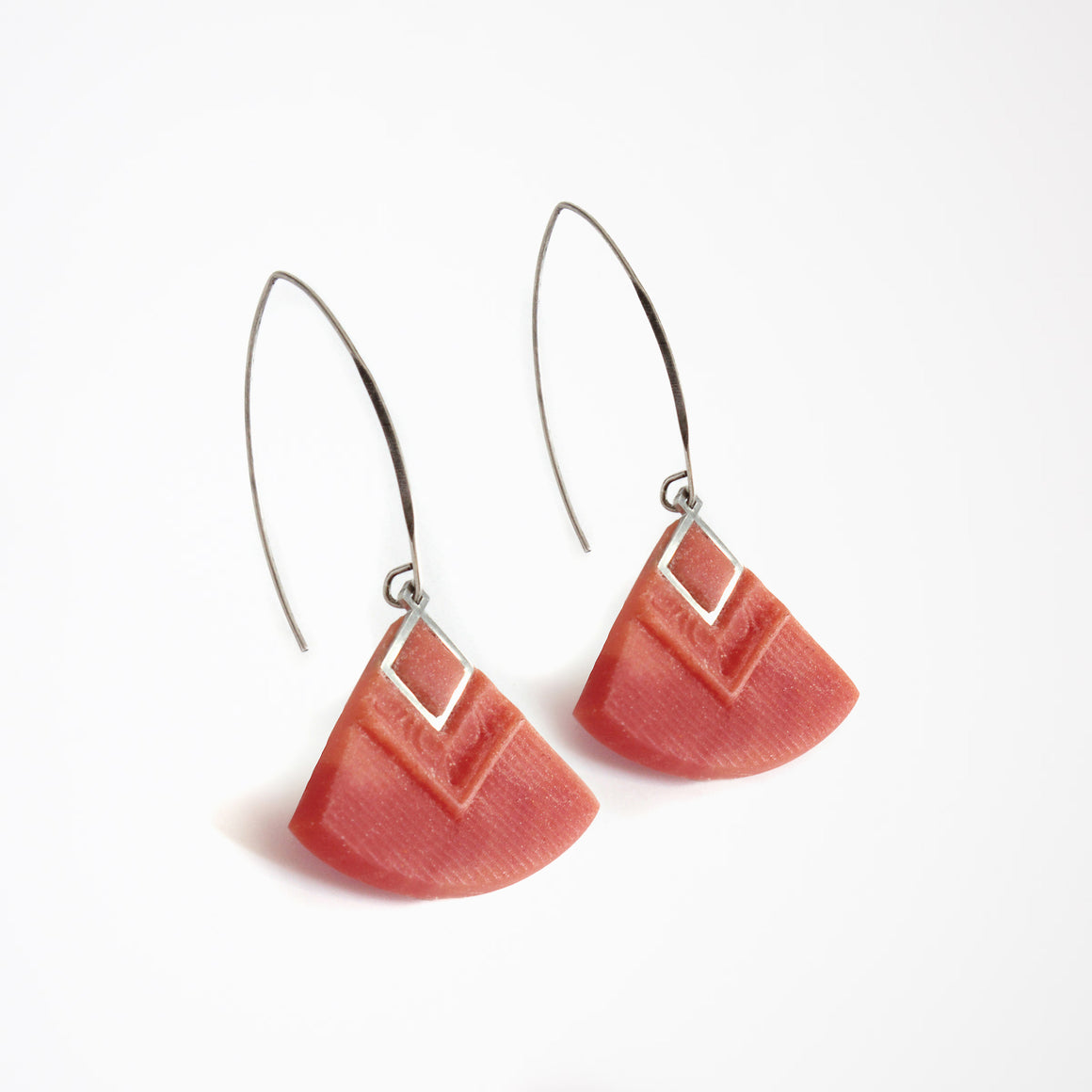 Woman Wearing a Cléopâtre Earrings in Grey - Handmade in Eco-friendly Resin - Sold by Chic & Basta