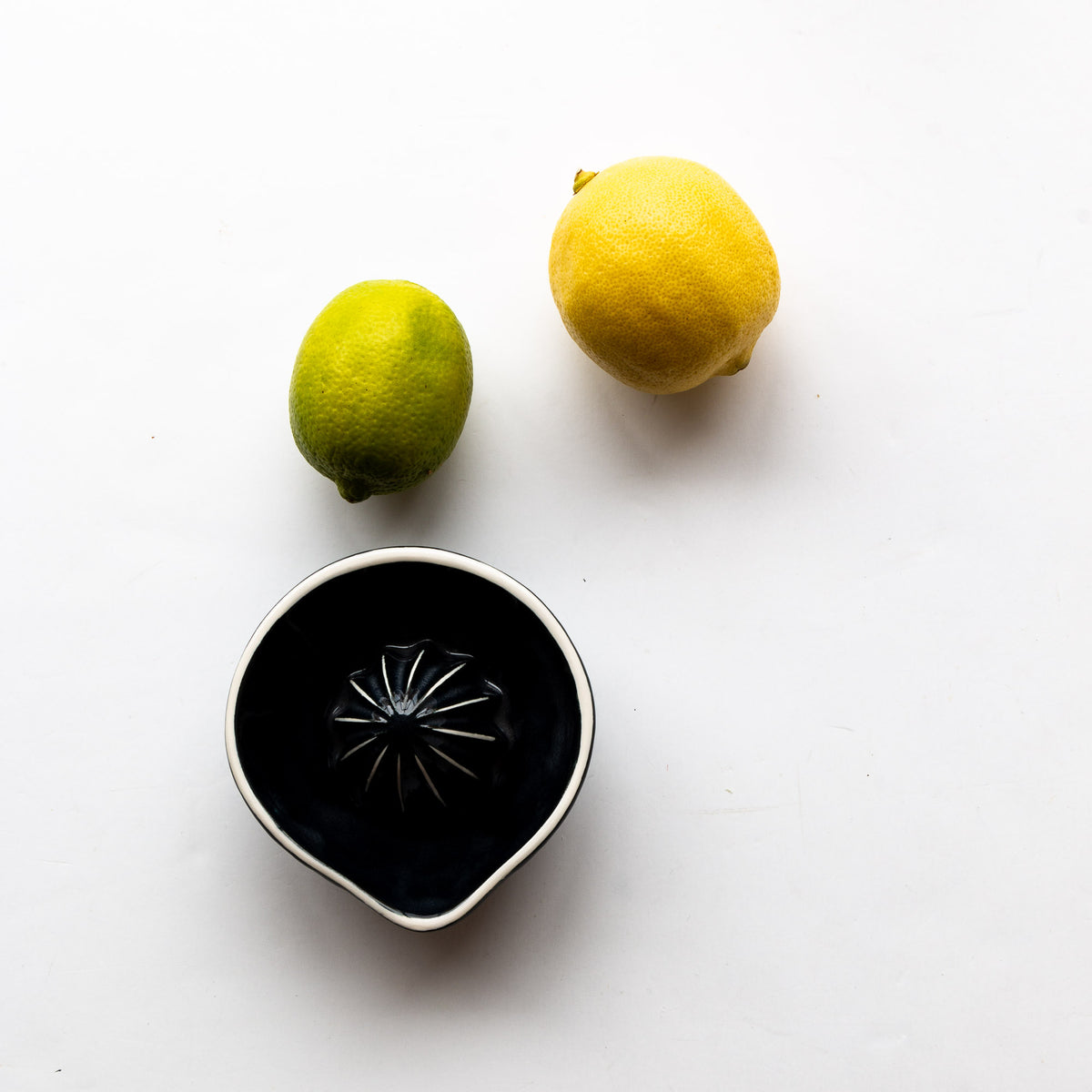 Top View With Citrus - Black & White Handcrafted Small Porcelain Citrus Juicer - Sold by Chic & Basta