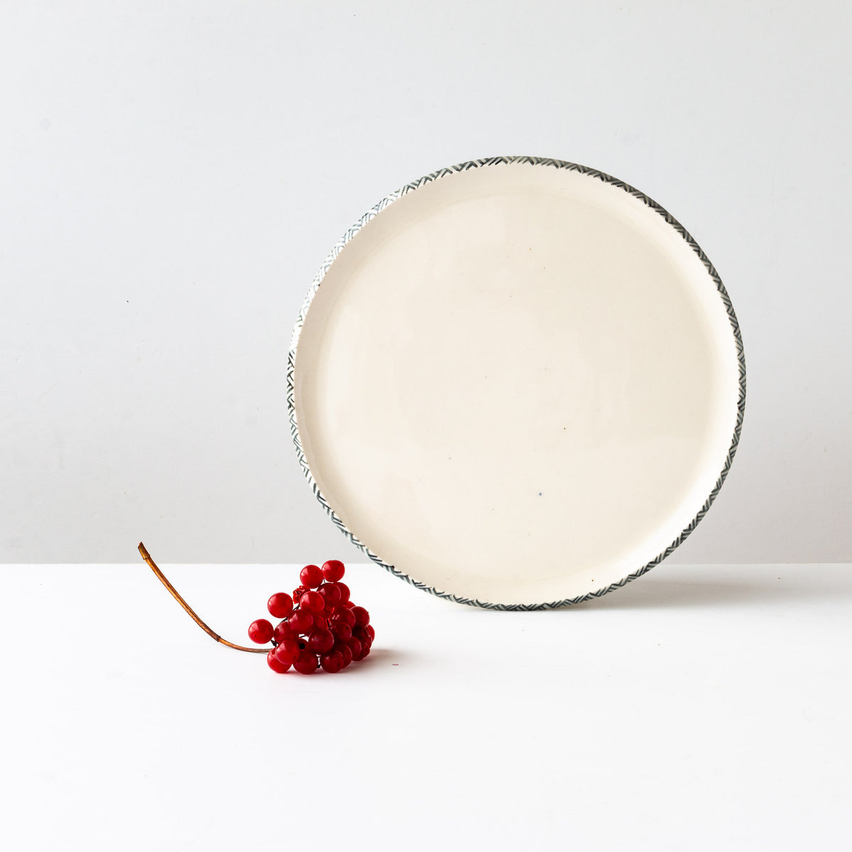 Front View - Handmade Porcelain Plate With Rim Adorned With a Painted Frieze - Sold by Chic & Basta