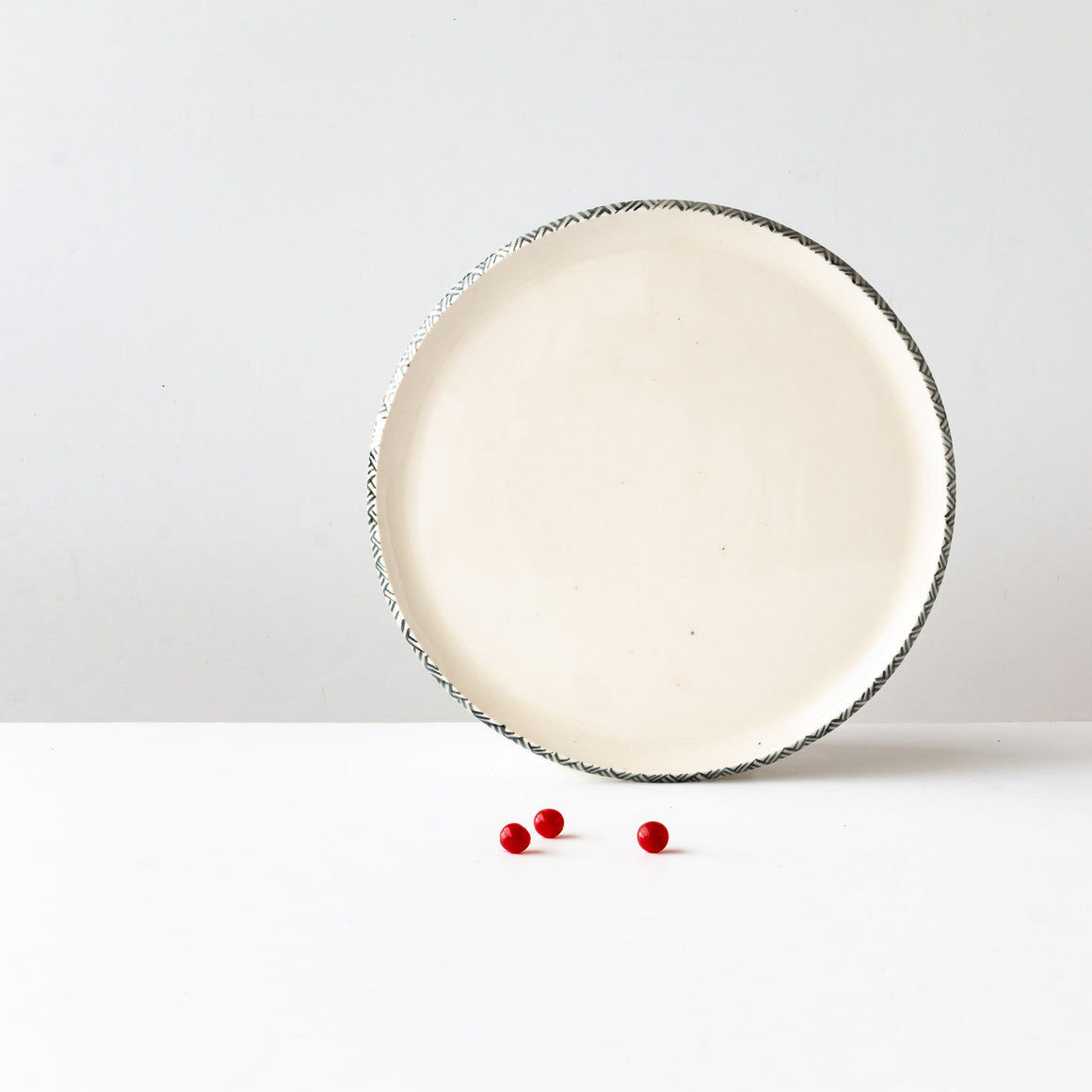 Three Handmade Porcelain Plates With Rim Adorned With a Painted Frieze - Sold by Chic & Basta
