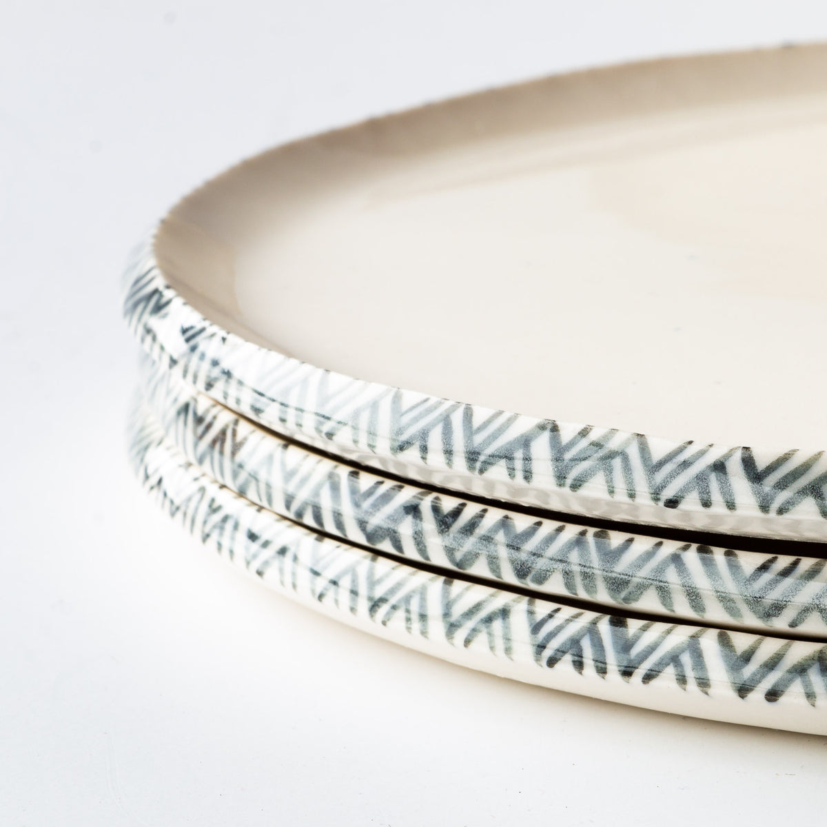 Rim Detail - Handmade Porcelain Plate With Rim Adorned With a Painted Frieze - Sold by Chic & Basta