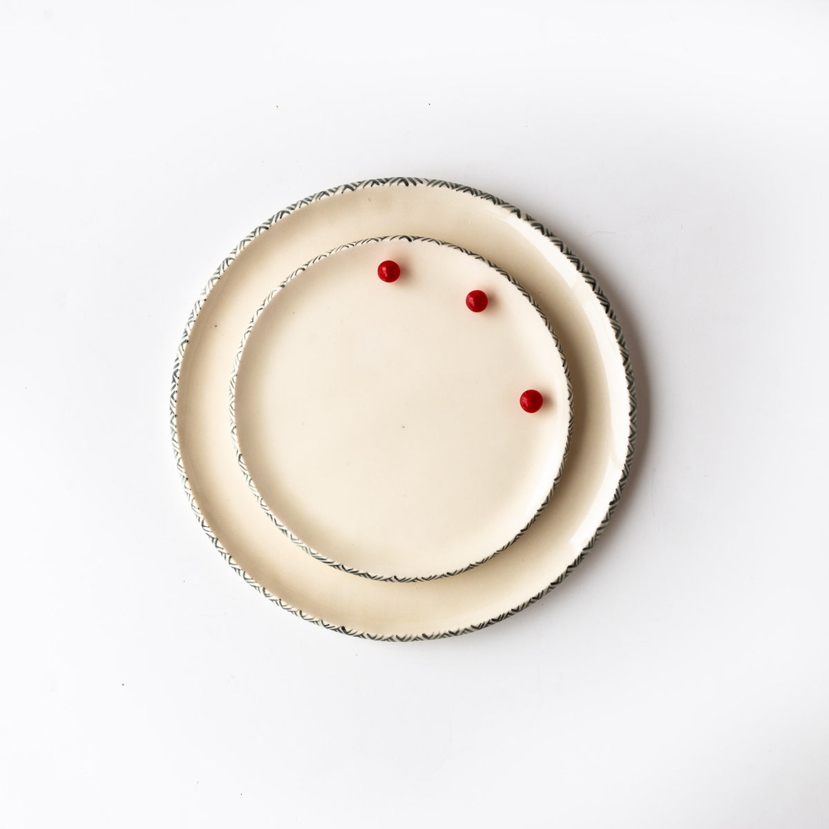 Top View - Small & Medium Handmade Porcelain Plates With Rim Adorned With a Painted Frieze - Sold by Chic & Basta