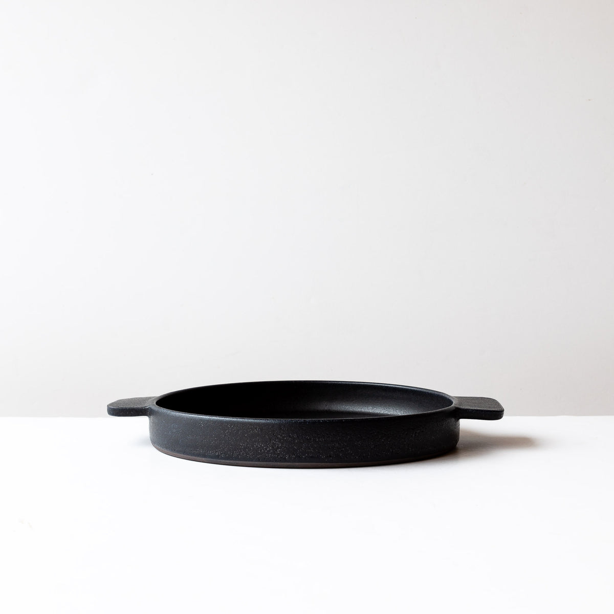 Side View - Black Handmade Round Stoneware Gratin Plate / Serving Plate - 10.5 Inch - Sold by Chic & Basta