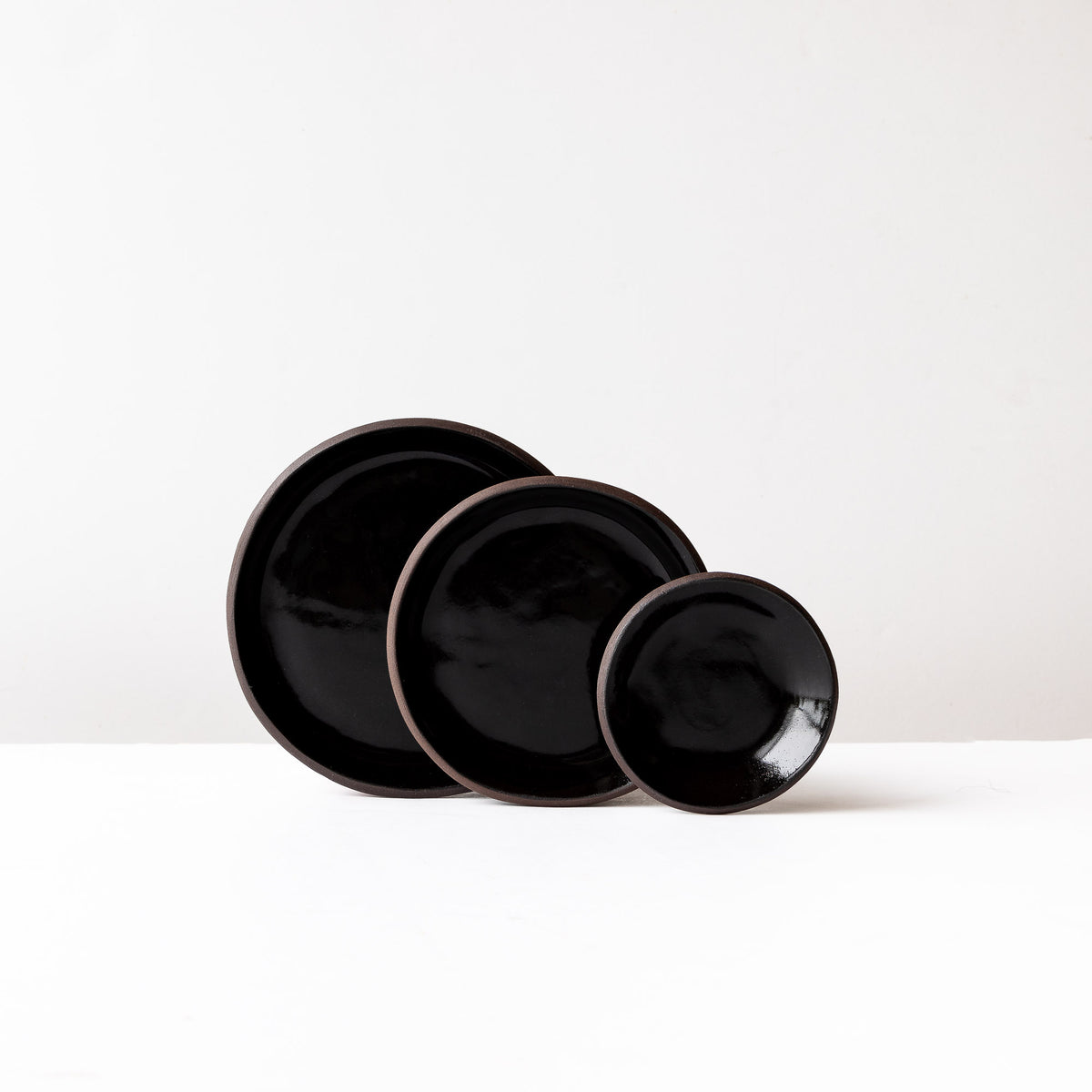 Three Handmade Saucers in Black Lacquered Stoneware - Sold by Chic & Basta