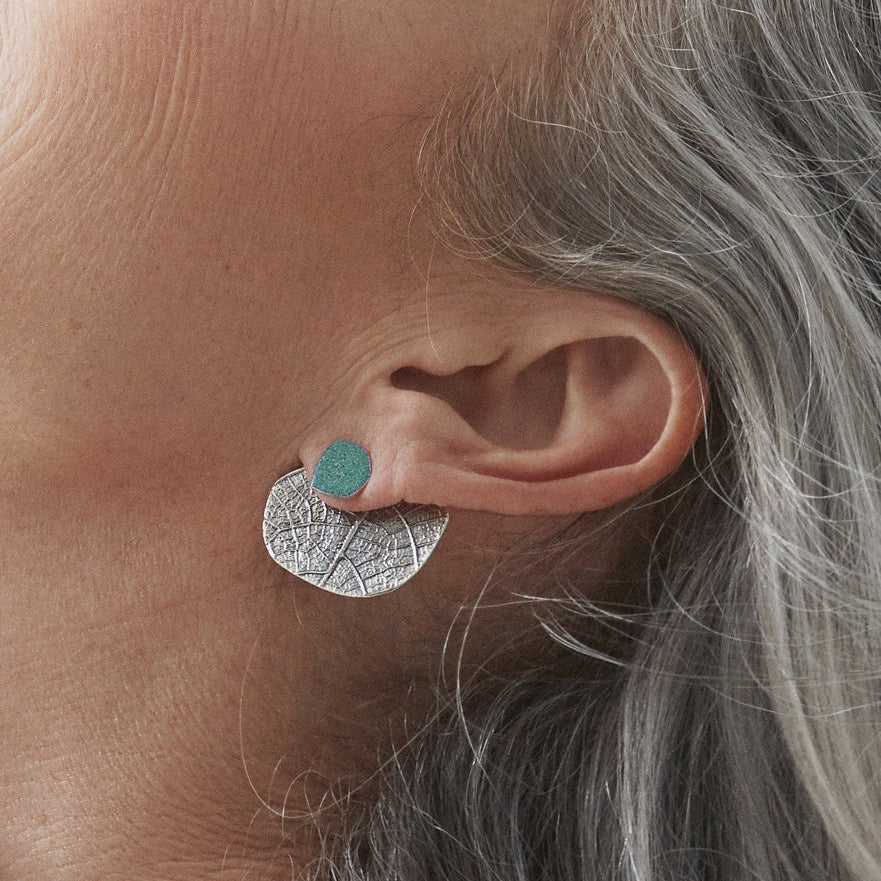 Close-up View of Model Wearing a Silver & Turquoise Color Ear Jacket Earrings - Sold by Chic & Basta
