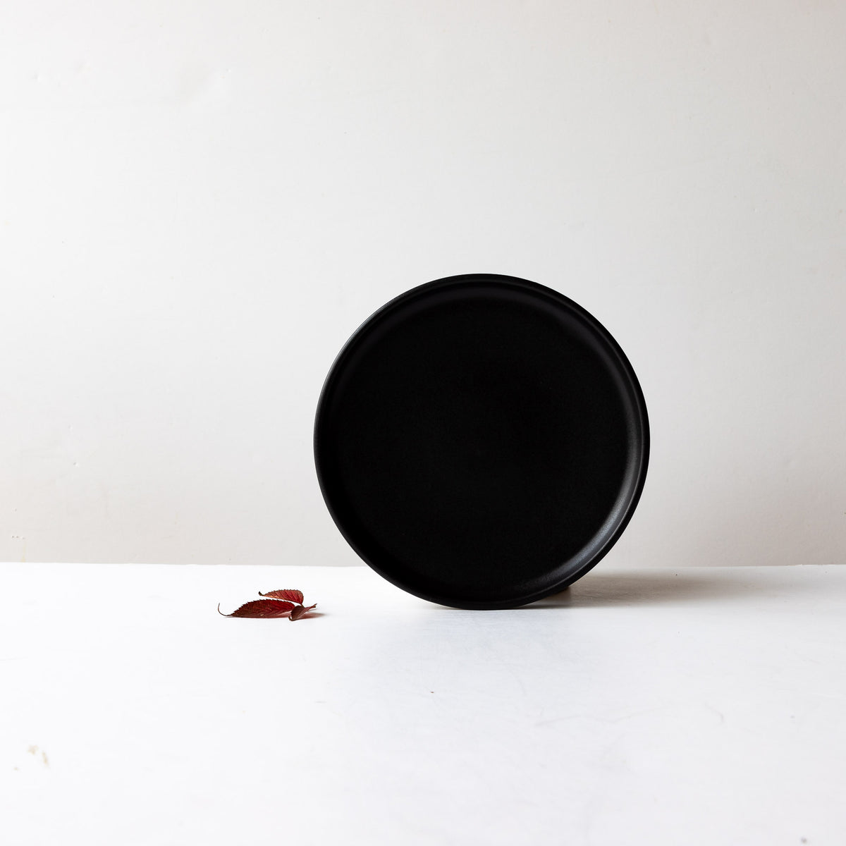 Black Satin Glaze Hand Thrown Small Porcelain Plate - Sold by Chic & Basta
