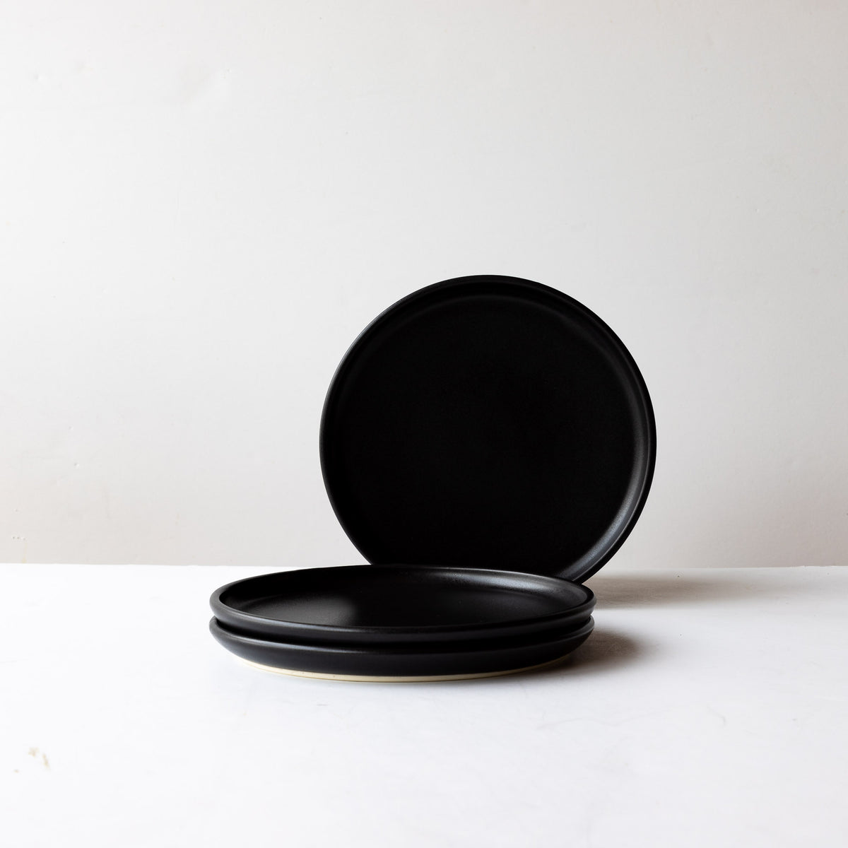 Three Black Satin Glaze Hand Thrown Small Porcelain Plates - Sold by Chic & Basta