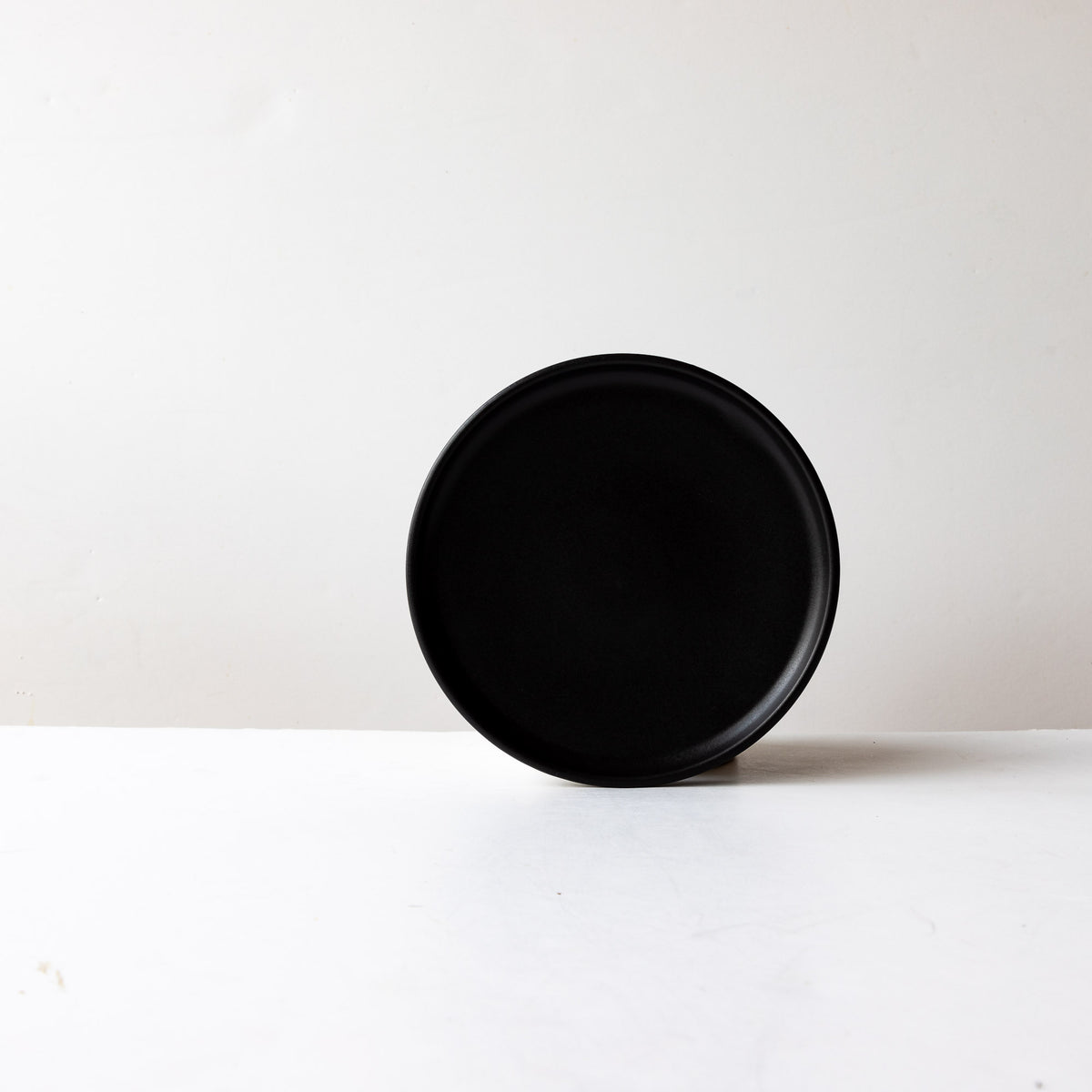 Front View - Black Satin Glaze Hand Thrown Small Porcelain Plate - Sold by Chic & Basta