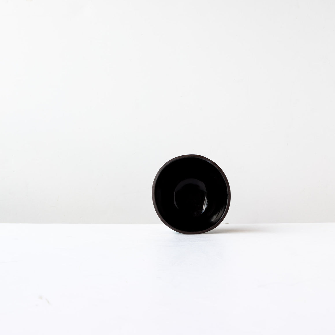 Two Handmade Small Bowls in Black Lacquered Stoneware - Sold by Chic & Basta