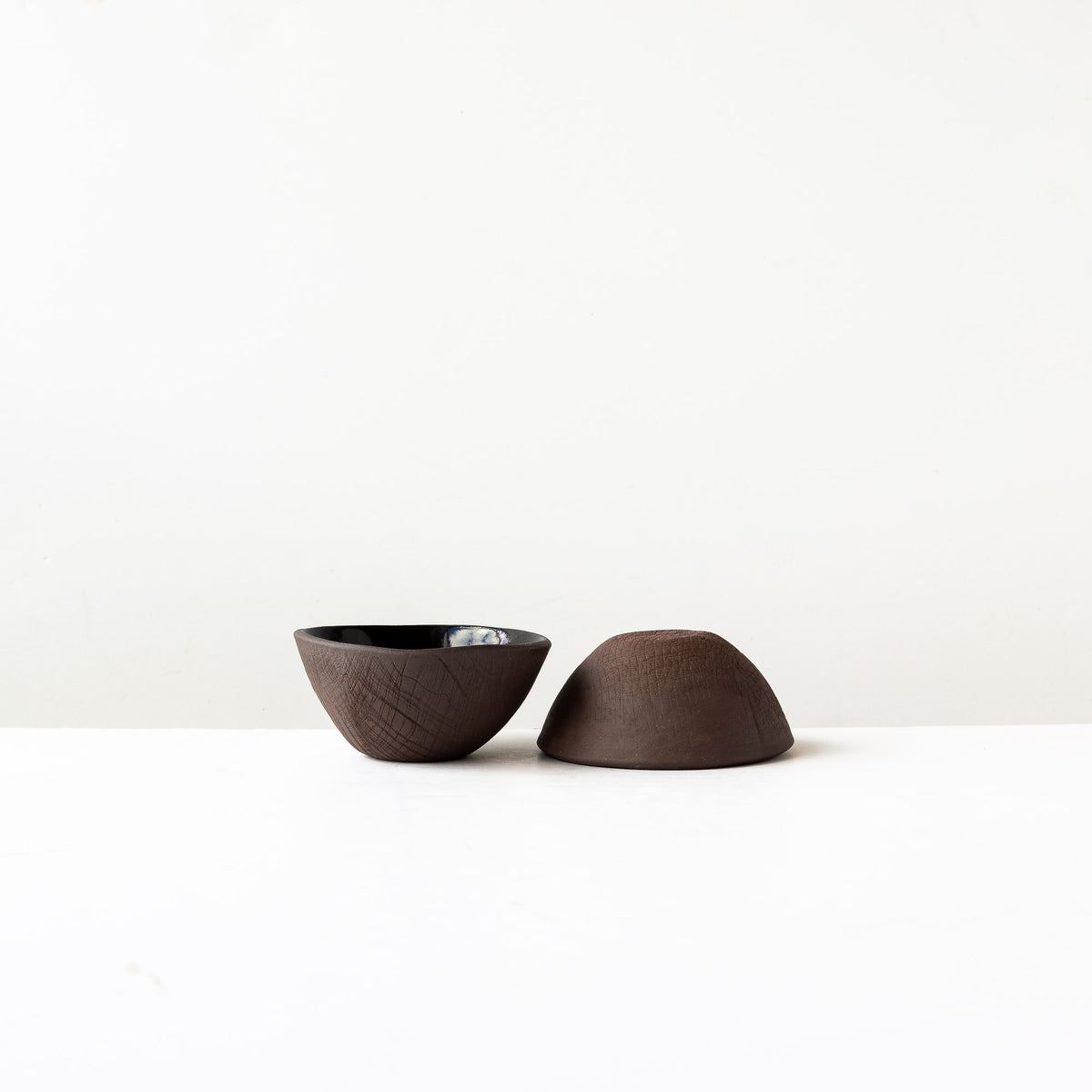 Side View - Two Handmade Small Bowls in Black Lacquered Stoneware - Sold by Chic & Basta