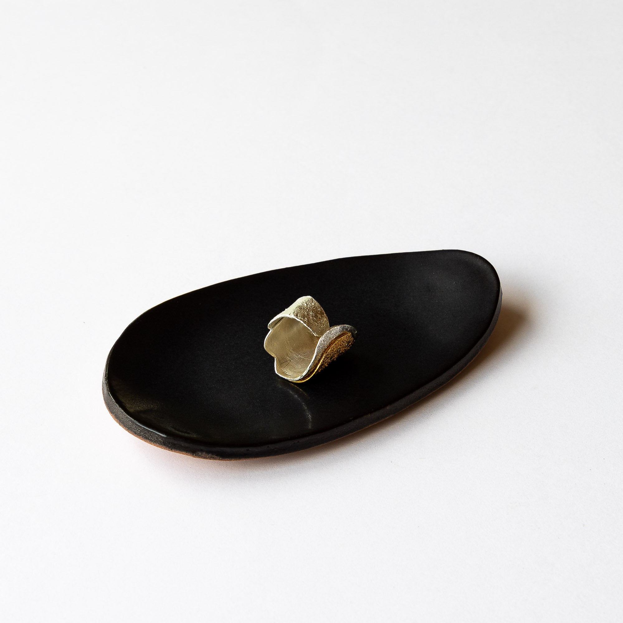 Shown With Silver & Gold Ring - Black Handmade Small Oval Stoneware Plate - Jewelry Dish - Sold by Chic & Basta