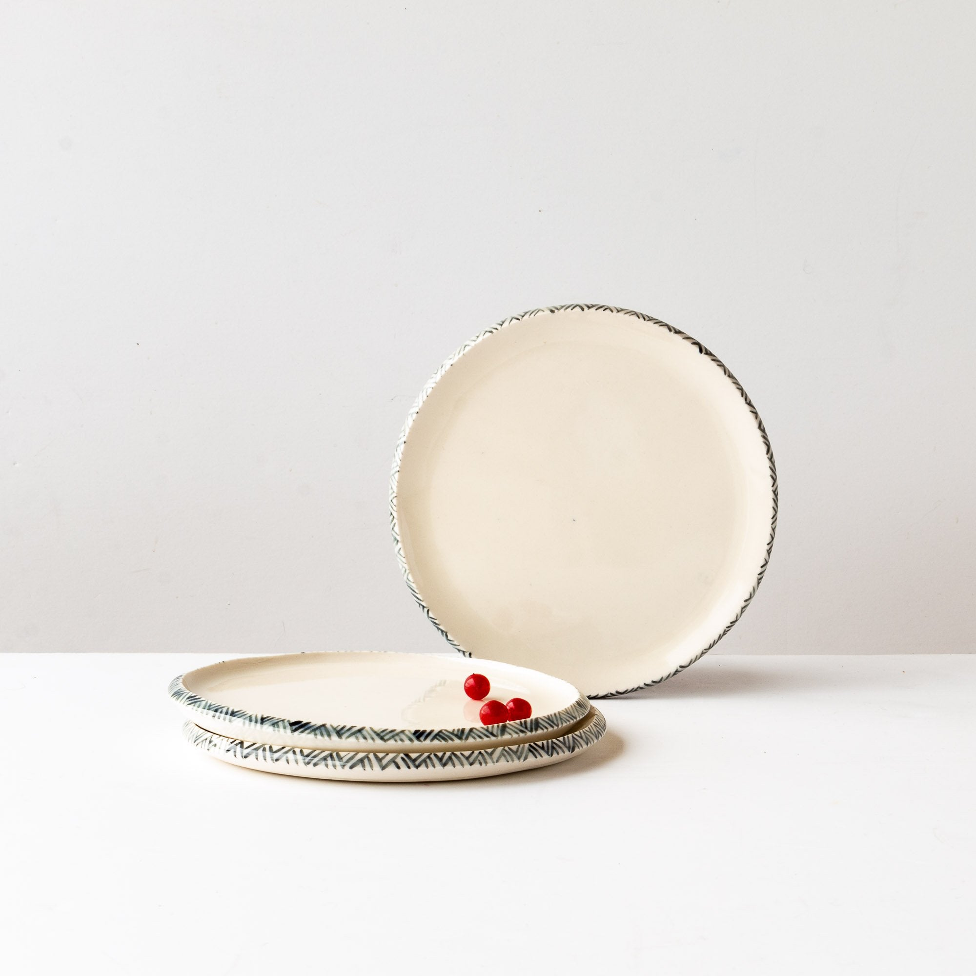 Three Small Porcelain Plates With Adorned Painted Frieze Rim - Sold by Chic & Basta