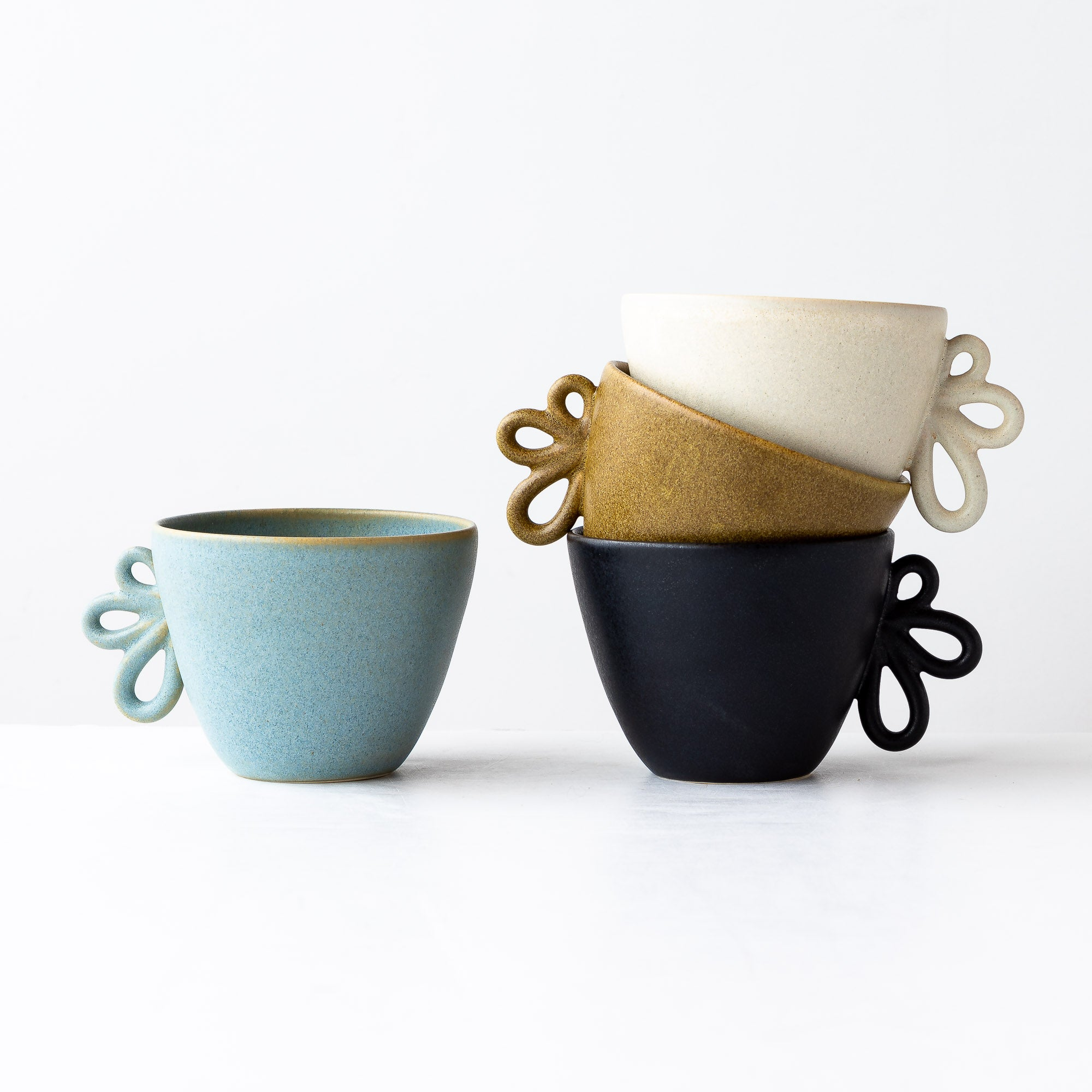 Four Small Round Wheel Thrown Stoneware Mugs - Sold by Chic & Basta