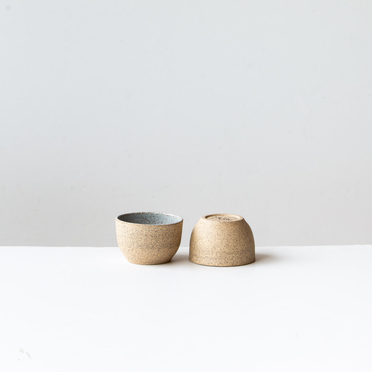 Two Small Speckled Stoneware Tea Bowls - Pale Blue Glaze - Sold by Chic & Basta