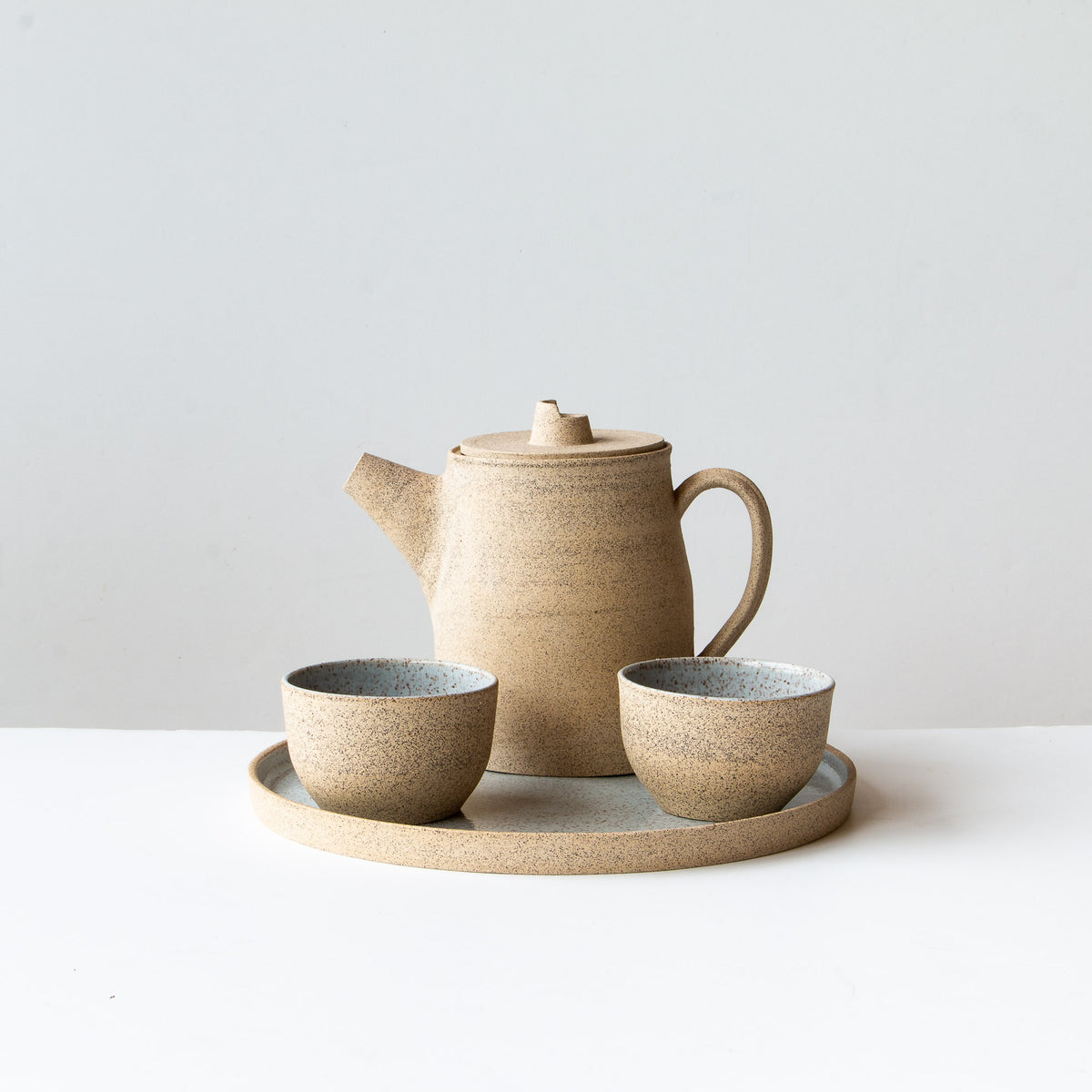 Shown With Cups & Plate - Speckled Stoneware Tea-pot - Pale Blue Glaze - Sold by Chic & Basta