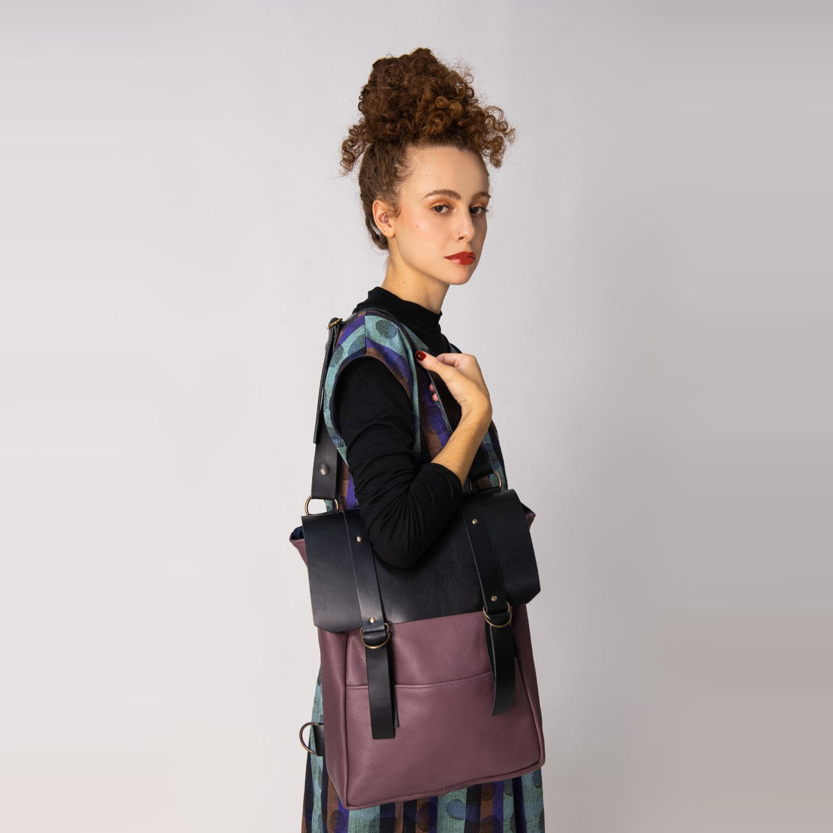 Model Wearing a Old Purple & Black Handcrafted Leather Backpack / Crossbody Bag - Sold by Chic & Basta