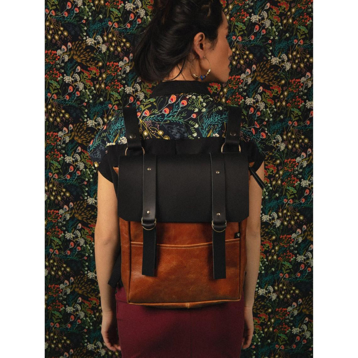 Model Wearing a Caramel & Black Handcrafted Leather Backpack / Crossbody Bag - Sold by Chic & Basta