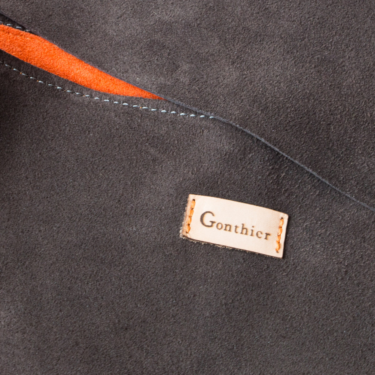 Detail - Greystone & Orange - Handmade Flap Purse in Calf Suede & Pork Suede Lining - Sold by Chic & Basta