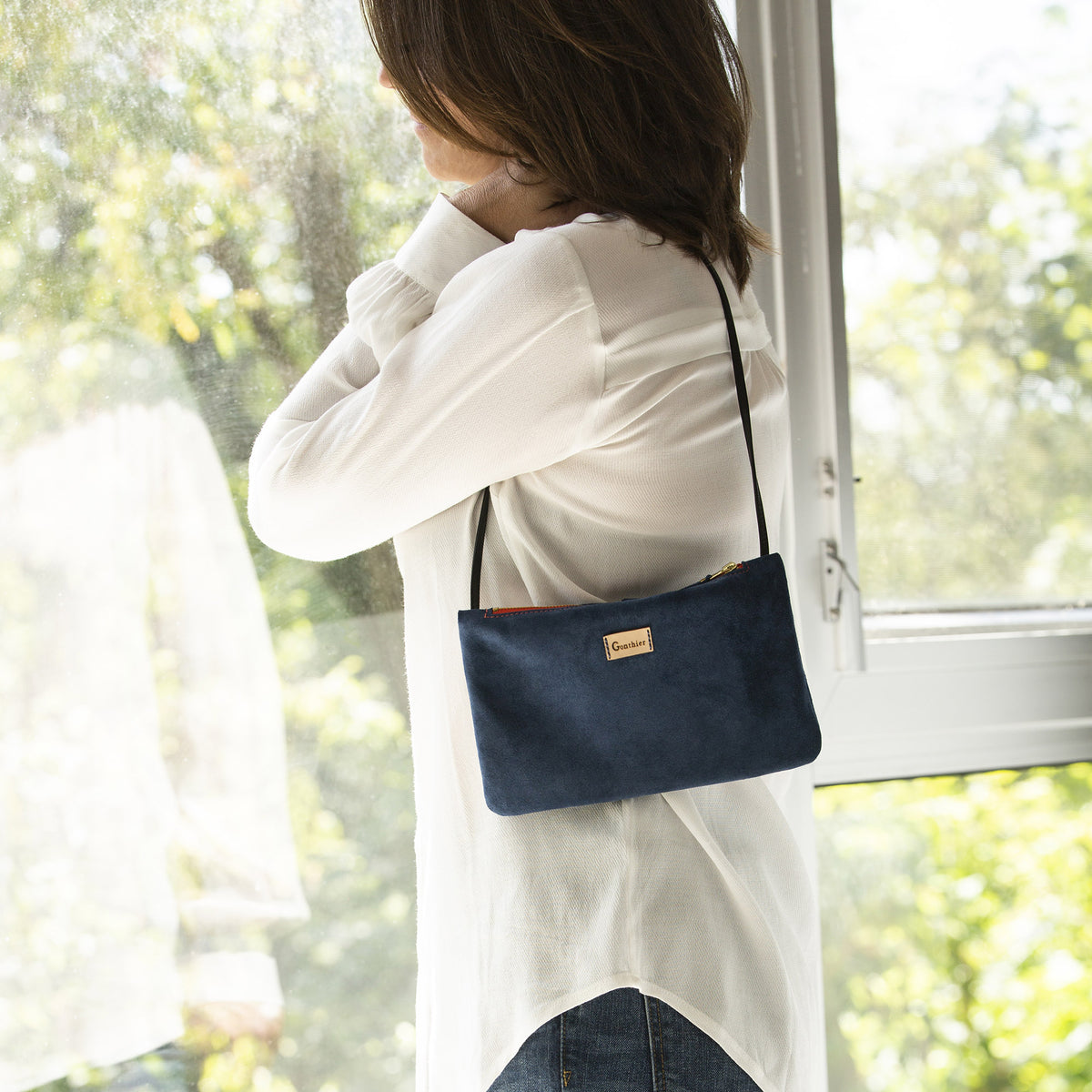 Model Wearing a Blue Handmade Small Shoulder Bag in Suede Calfskin