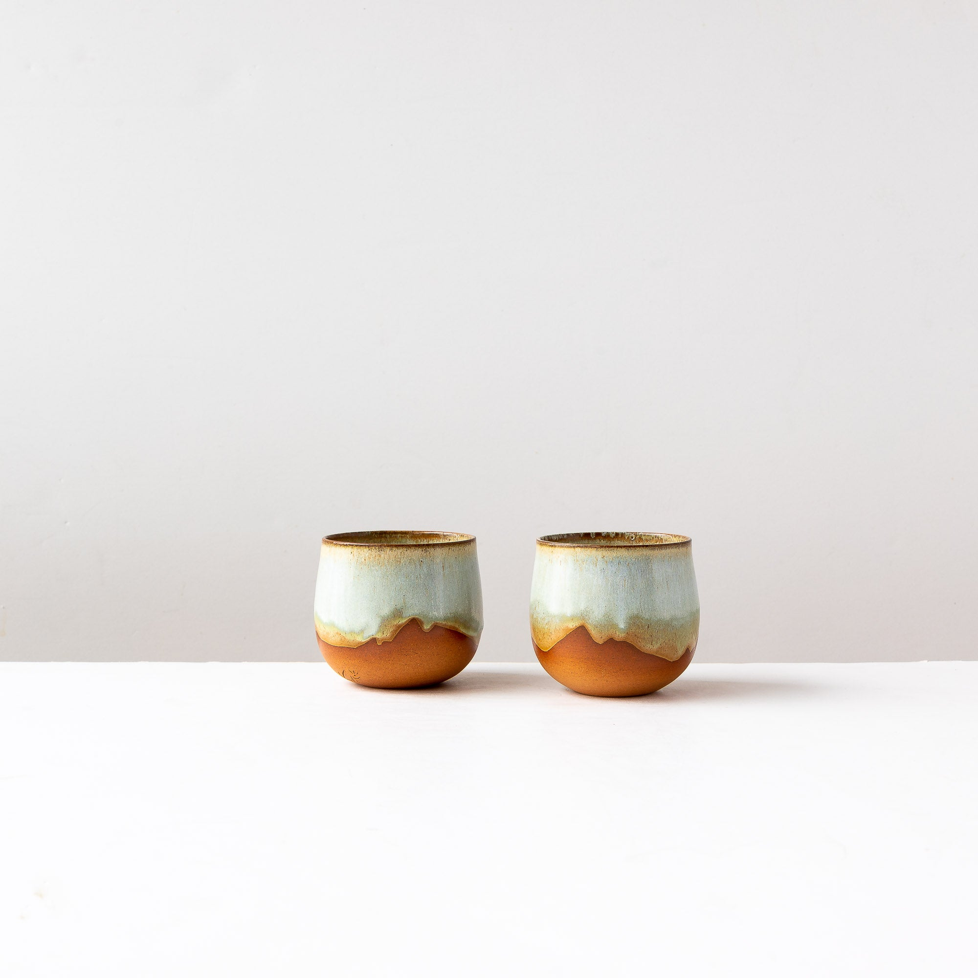 Two Handthrown Tea Bowls in Red Stoneware & Turquoise Glaze - Sold by Chic & Basta