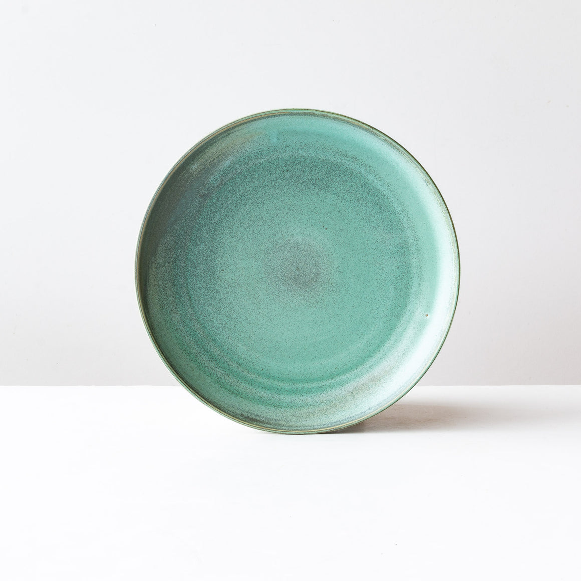 A Pile of Handmade Turquoise Ceramic Stoneware Dinner Plates - Sold by Chic & Basta
