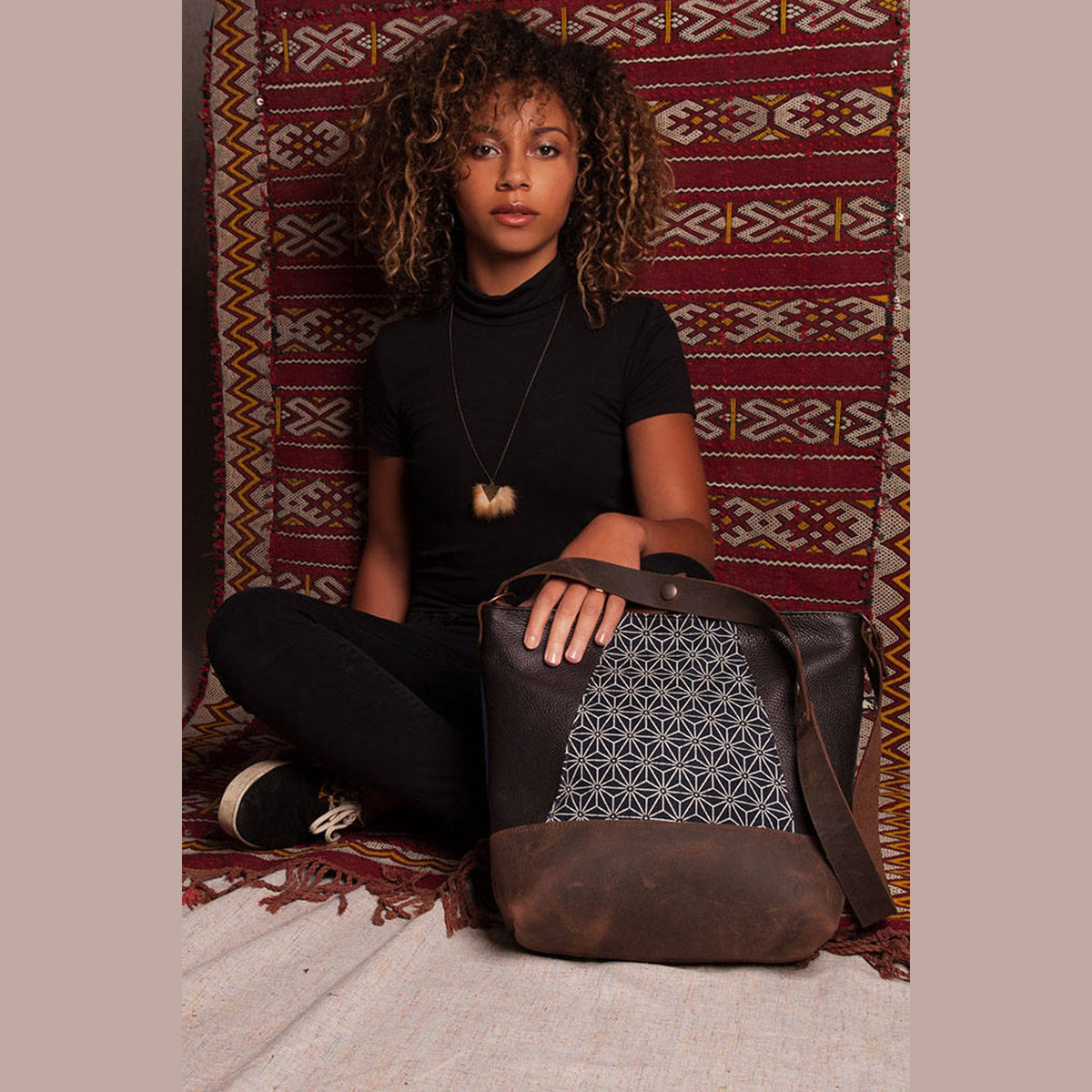 Model Wearing an Adjustable Leather Shoulder Bag with Japanese Fabric - Sold by Chic & Basta