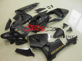 Matte Black and Gold Fairing Kit for a 2003, 2004 Honda CBR600RR motorcycle