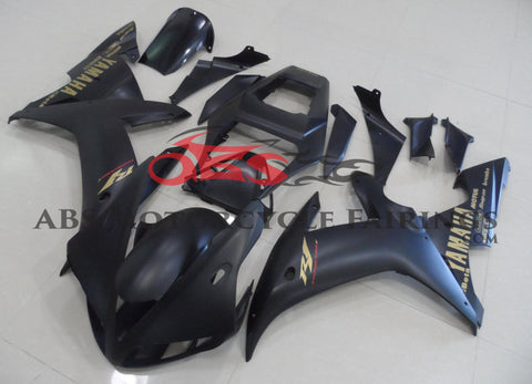 Matte Black and Gold Fairing Kit for a 2002 & 2003 Yamaha YZF-R1 motorcycle