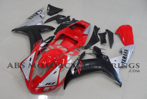Red, Matte Black and Silver Fairing Kit for a 2002 & 2003 Yamaha YZF-R1 motorcycle.