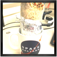 Coffee mugs make a great holder for a burrito