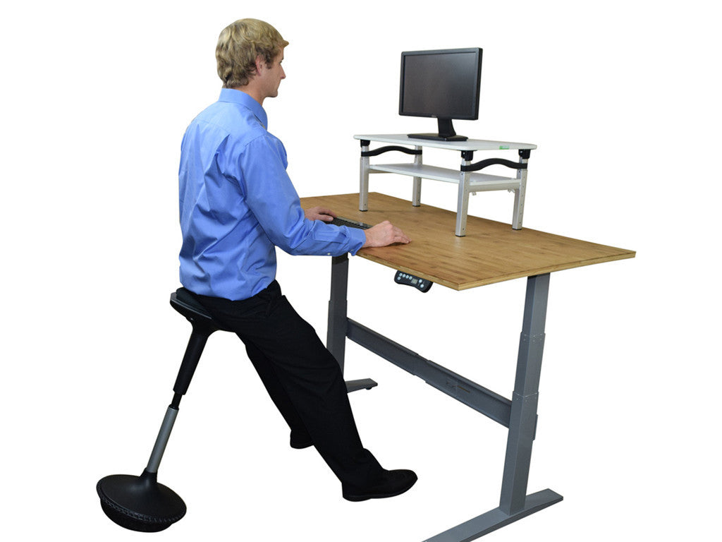 Man Sitting on Wobble Stool - StandDesk