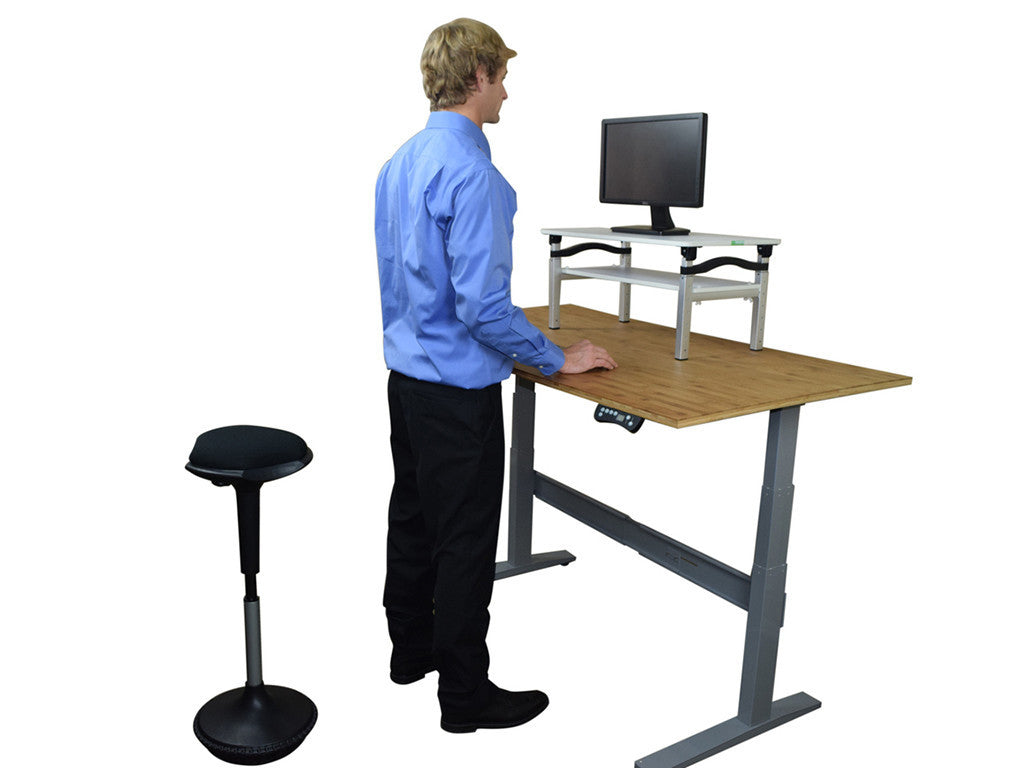 Man Standing by Wobble Stool - StandDesk