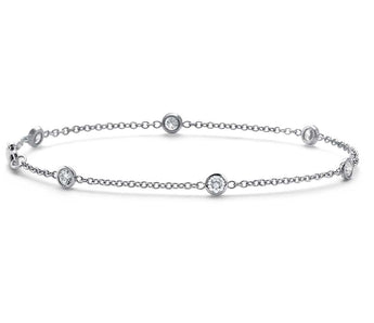 DIAMOND BEZEL BRACELET IN 18K WHITE GOLD  (1/2 CT. TW.)