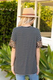 T9958-ANBLK animal and stripes color block v-neck pocket top