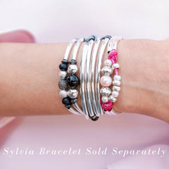Vitality free pearl bracelet in pink leather shown stacked with the Sylvia bracelet necklace